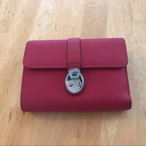 Tumi leather wallet in magenta
